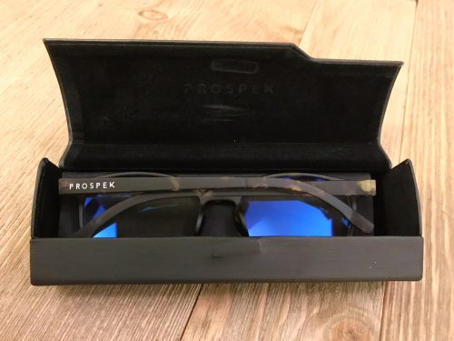 Spektrum Prospek Artist Computer Glasses in their protective case on a wooden counter