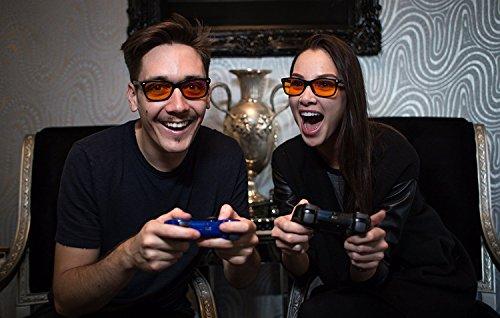 Man and woman wearing swannies gamer eyewear while playing video games